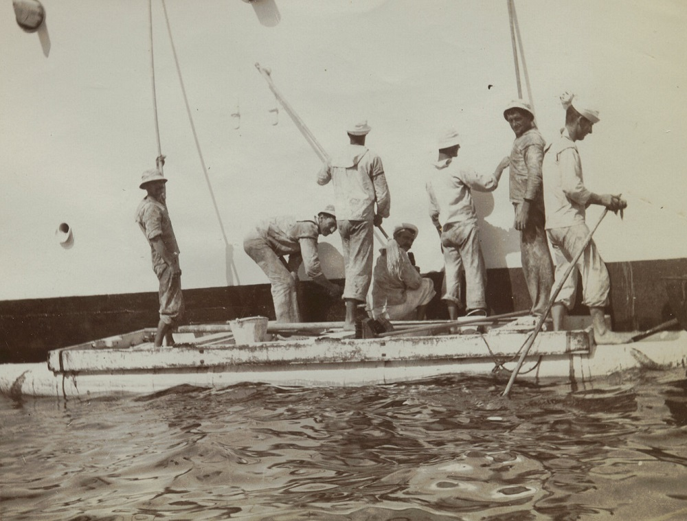 Sailors scrubbing side of OLYMPIA